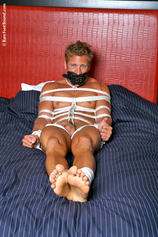Bare Foot Bound stud tied up in rope and tickled