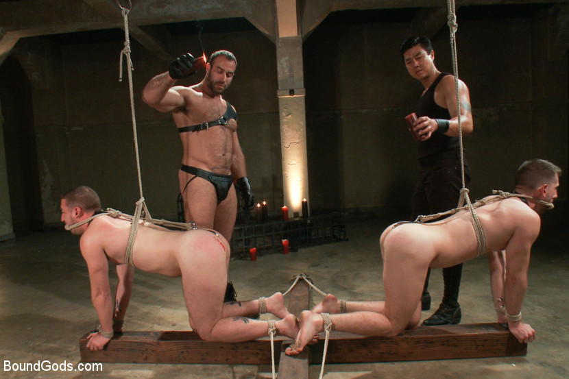 Spencer Reed ties up and fucks two slave boys during a live show at Bound Gods