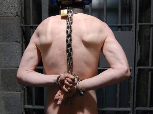 Men in heavy locking metal bondage