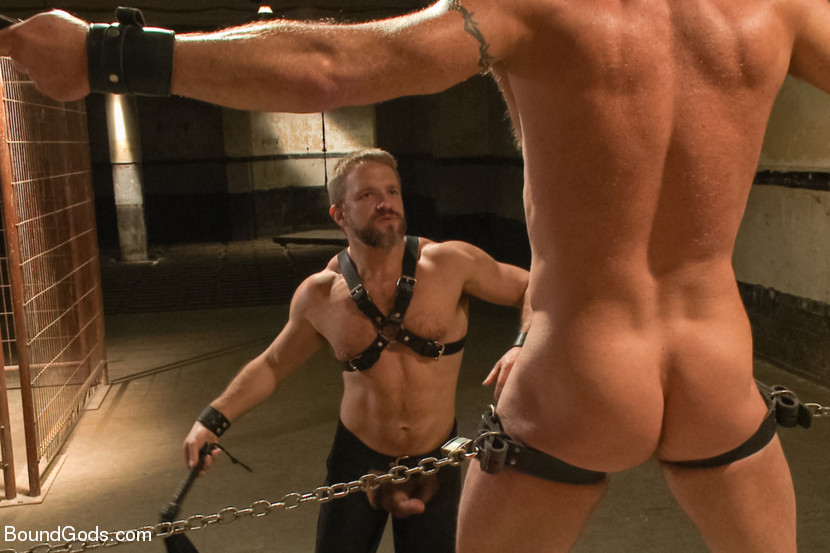 Chad Brock is tied up, zapped, caned and fucked by Dirk Caber
