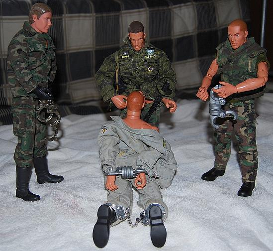 Even GI Joe likes to play with handcuffs