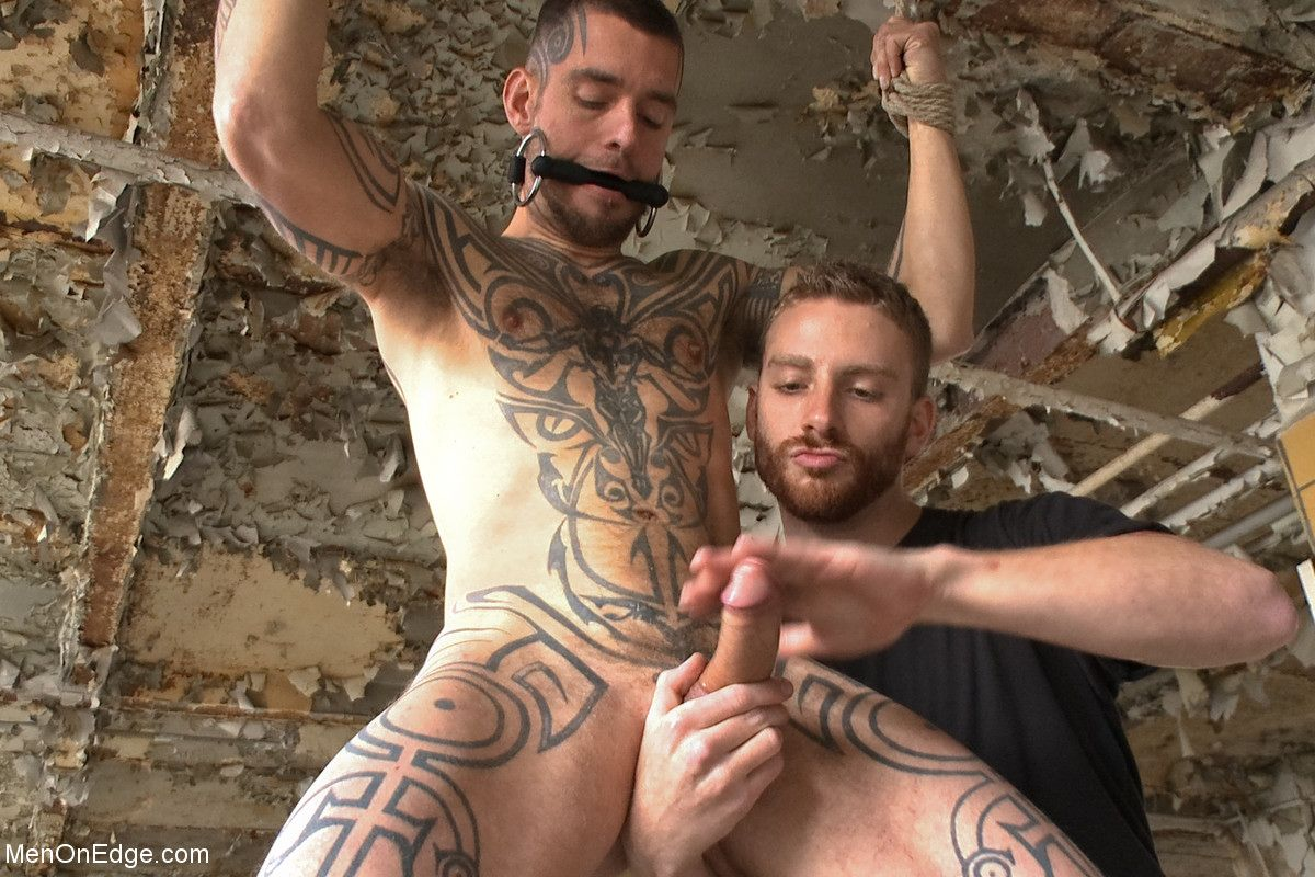 Tatted gay porn star Logan McCree is featured at Men On Edge