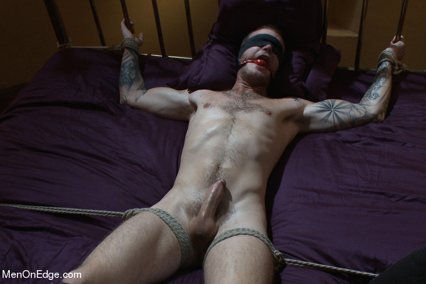 The vibrators on his cock head bring him to the edge again and again