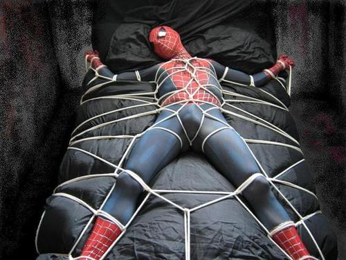 Spiderman tied to bed