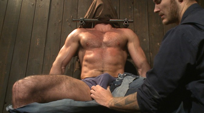 Muscle captive Billy Santoro submits to the hands of Christian Wilde