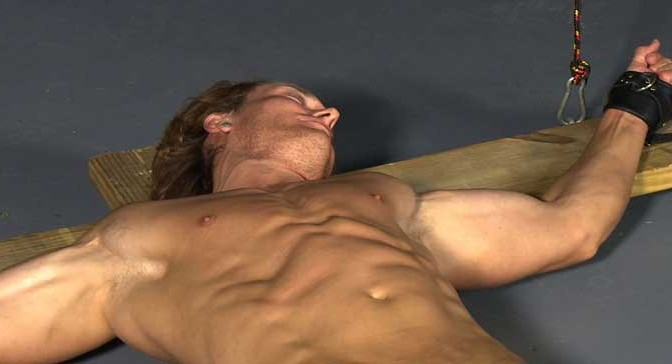 Video: Blond muscle stud Chris is crucified, his magnificent body stretched and tortured for eight hours on the cross