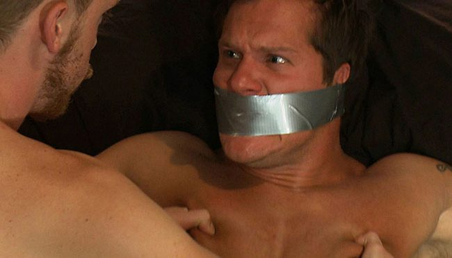 A bold Peeping Tom breaks into a stud's apartment and ends up as the bondage victim