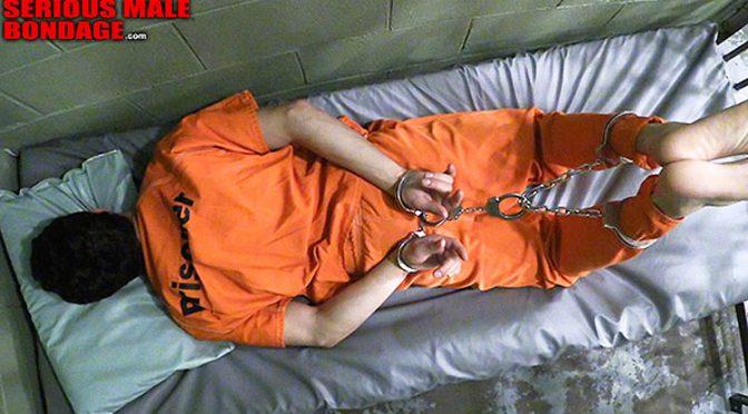 Hogtied in metal cuffs