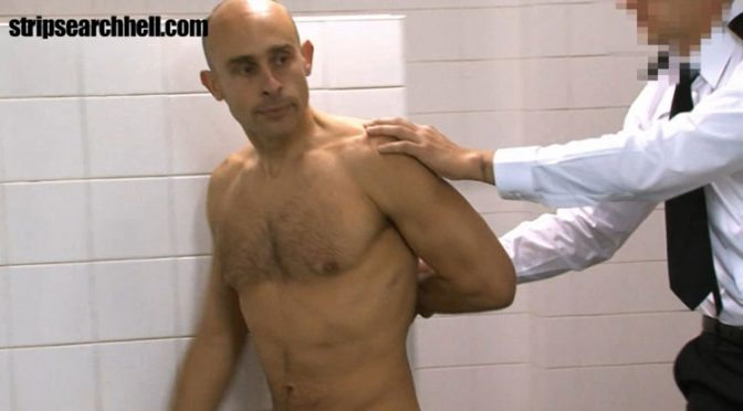 Stripped naked in front of prison guards and fellow inmates