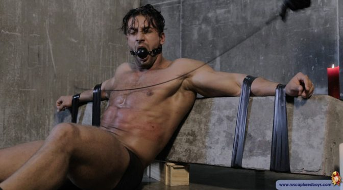 A muscle guy gets tied up, gagged and tortured