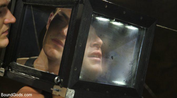 Christian Wilde locks Jacob Durham's head in a bondage box