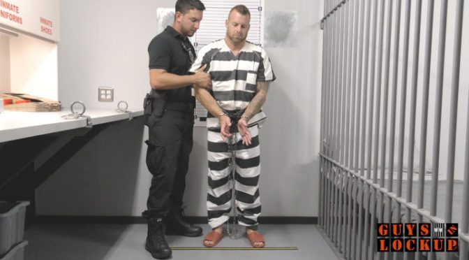 A prisoner gets his ass probed while handcuffed in jail intake