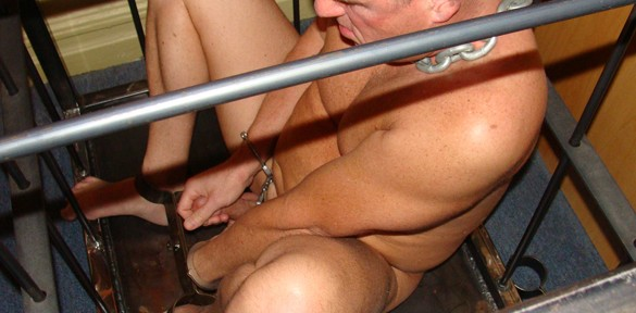 Metalbond locks another dude's cock in chastity when he's in a cage