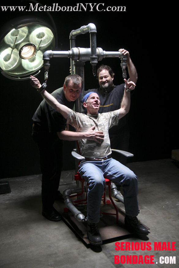 Ed and Chuck lock Jamie in a metal chair