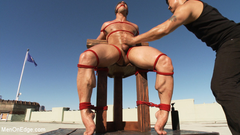 Bodybuilder John Magnum gets tied up, suspended, dildo fucked and edged
