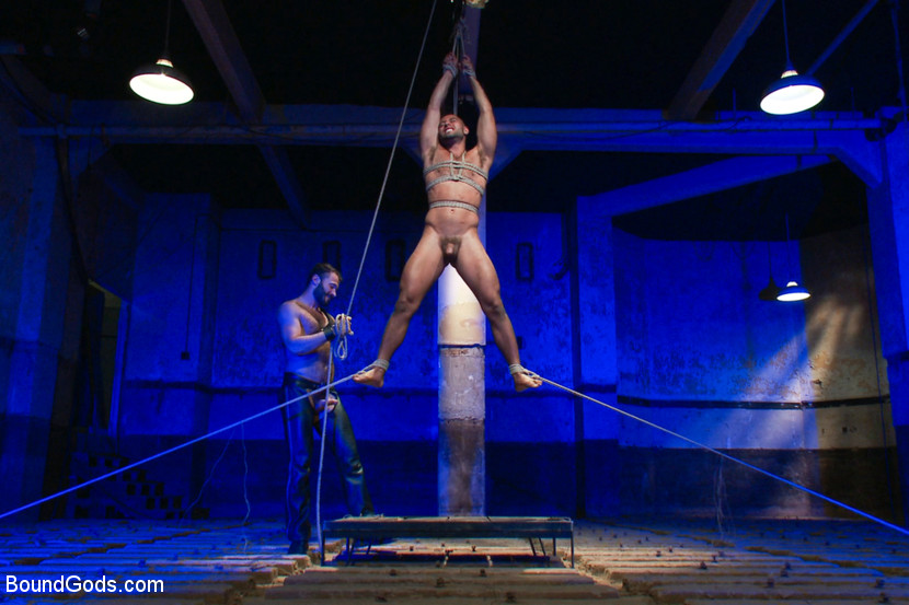Leo Forte hangs under his own power under the watchful eye of Wilfried Knight