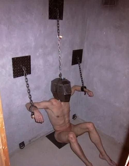 Men in heavy locking metal bondage 11