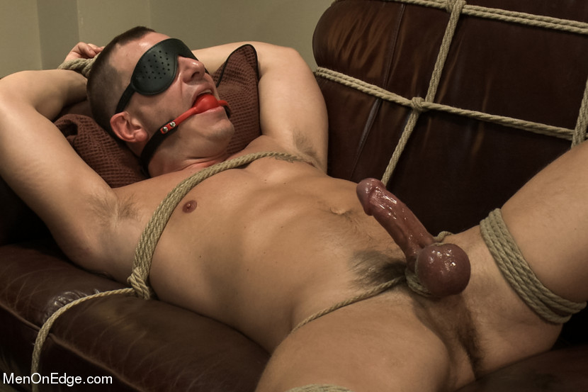 Finally, tied to the couch and blindfolded, Adam shoots a fat load all over himself, shooting farther than he ever has before.