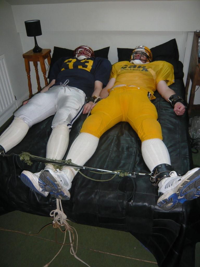 Tied up in football gear 02