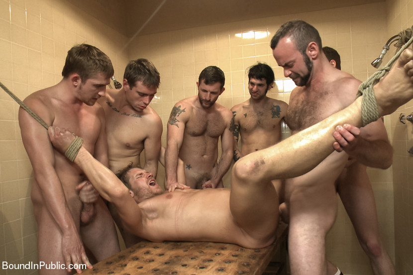 Morgan Black bends Alex over the naked men and fucks his hole hard as the locker room is filled with Alex's screams. The guys finally take the loudmouth meathead to the shower, where they each take turns fucking his hole and shower him with piss and cum. After having his fat cock edged, Alex cums all over himself and is left tied up, wet and helpless in the shower.