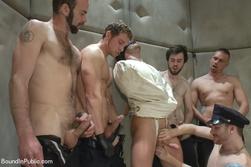 Jeremy Stevens has his ass flogged and fucked while bound in a padded cell full of horny guards