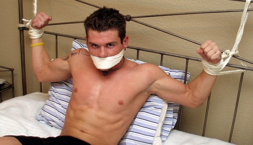 Tied to the bed and gagged