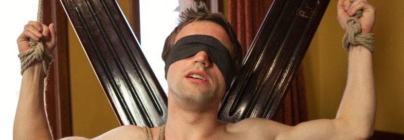 A bondage twink has his ass played with and his cock teased during his first edging session