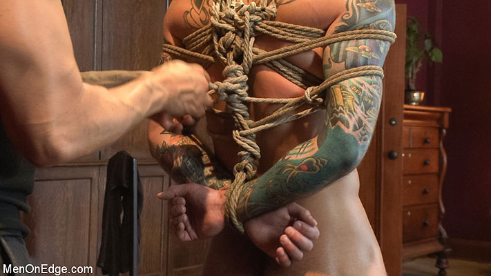 Tatted-up hunk Atticus has his cock edged and his hole fucked