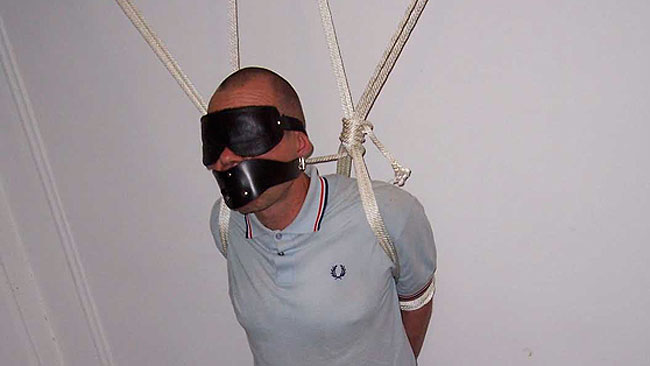 Skinhead from Europe roped to wall