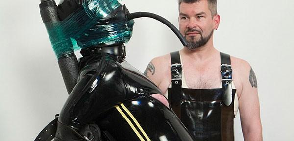 Rank's rubber bondage prisoner