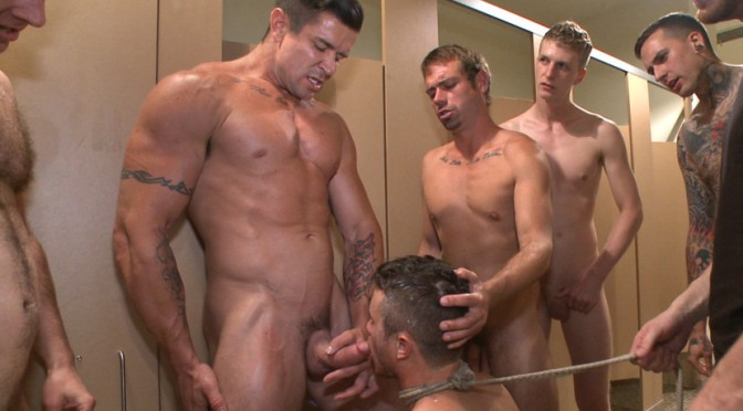 Bound to the urinals, Leo Sweetwood has his hole pried open as men shove a fucking machine up his ass