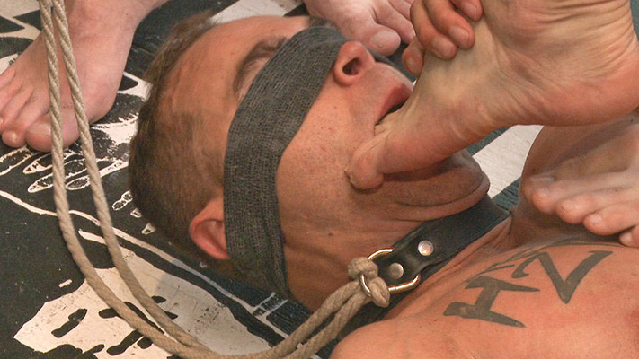Brock Avery gets smothered by male feet and cum