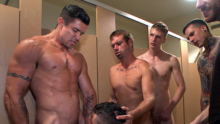Bound to the urinals, Leo Sweetwood has his hole pried open