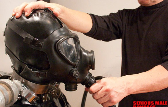 Rubber, steel bondage and a gas mask