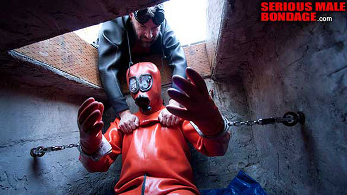 Bound in three layers of gear at Serious Male Bondage