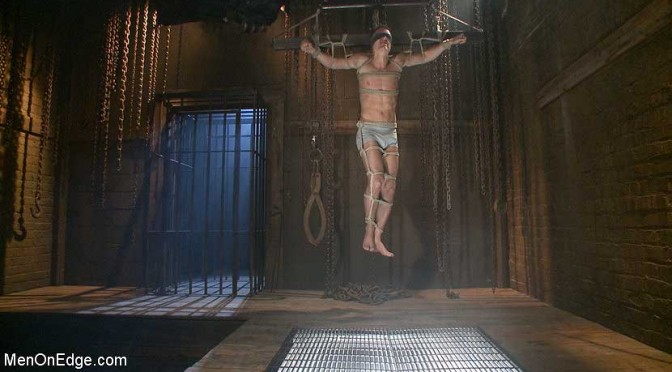 Extreme male bondage: Tyler Rush gets tied in a crucifixion