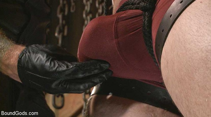 Male BDSM porn: Guy next door held in a stock, facefucked and flogged