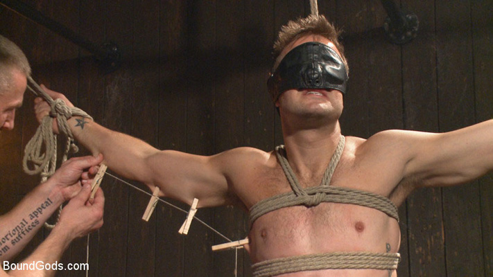 Male BDSM porn: Tormented in tight metal bondage