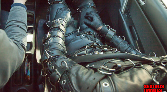Video: Leather bondage suit in public