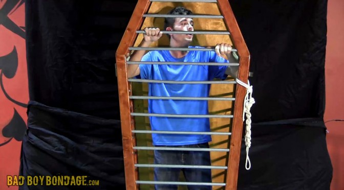 Trapped in a cage and made to remove his clothes