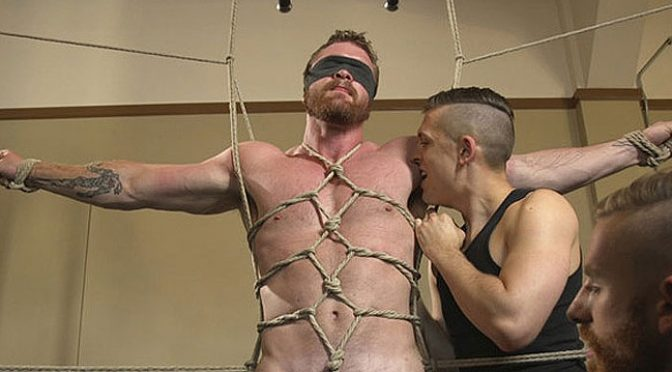 A muscular ginger gets tied up and edged at the gym