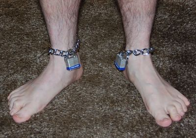 chained by the ankle
