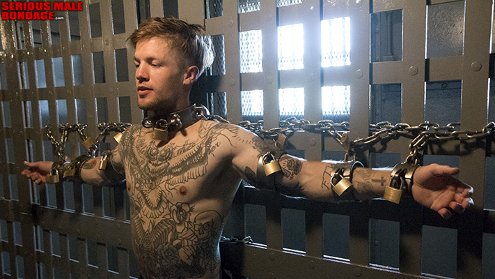 JimmyUSMC gets chained to the bars of a jail cell
