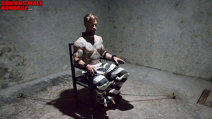chained in a bondage chair