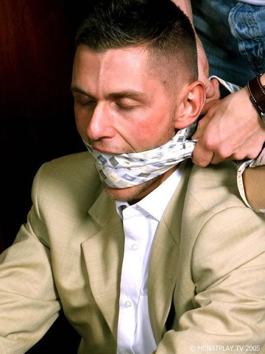 men in power suits tied up