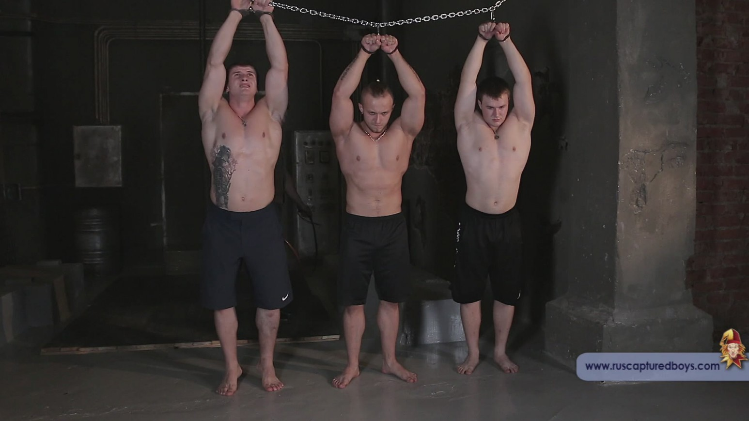 Bound and tortured muscle men