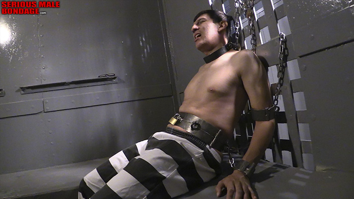 Chained up in a jail cell