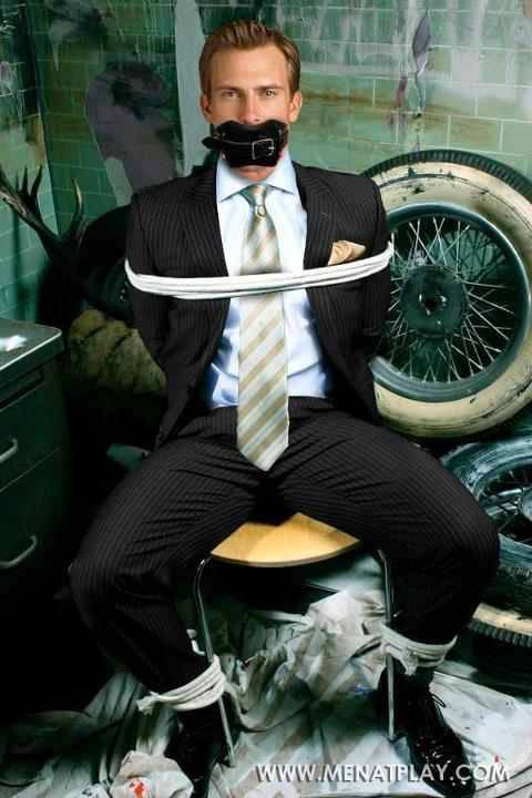 Man In Suit Tied Up