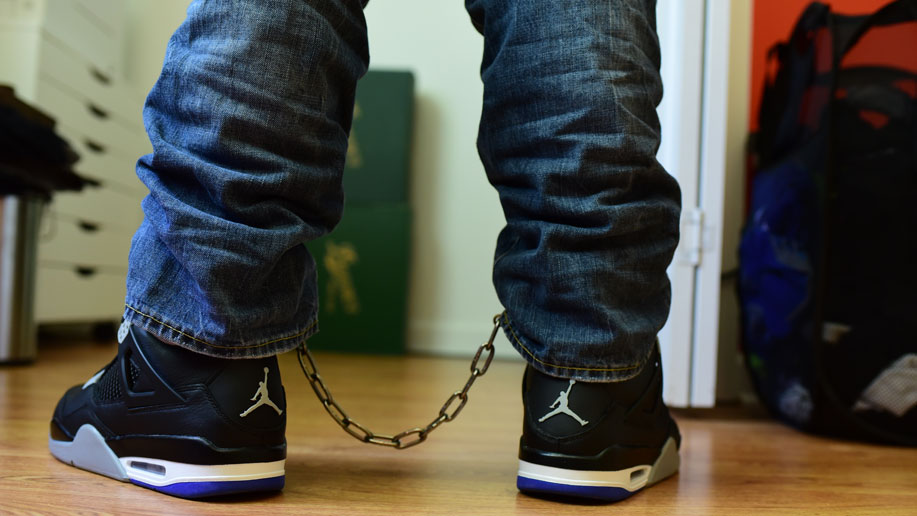 Pictures: Leg cuffed while wearing sneakers
