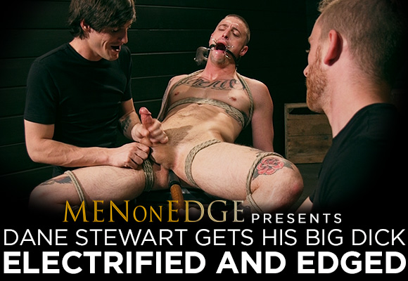 tattooed stud Dane Stewart gets his big dick electrified and edged